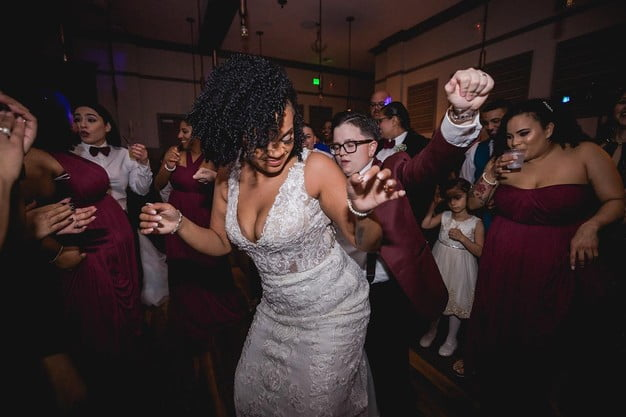 brides dancing together on the dance floor