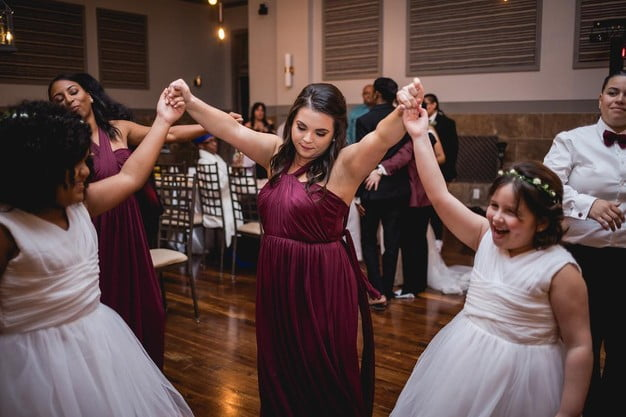 Bridesmaids dancing with flower girls