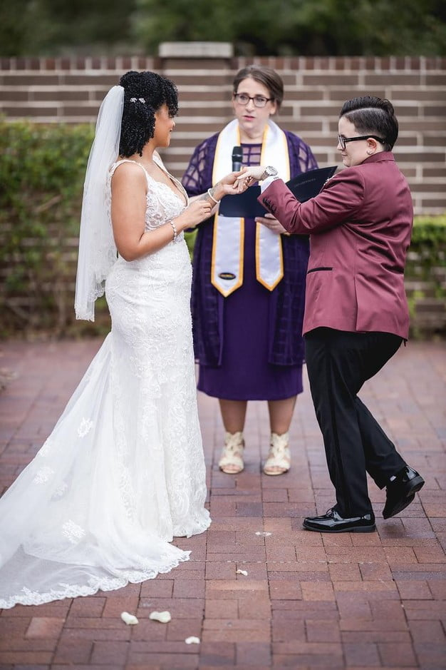 wedding couple exchanging rings