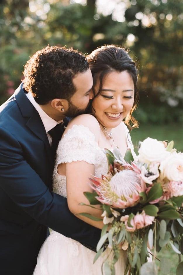 Orlando Florida Federation of Garden Clubs Romantic Wedding Couple Embrace Kiss